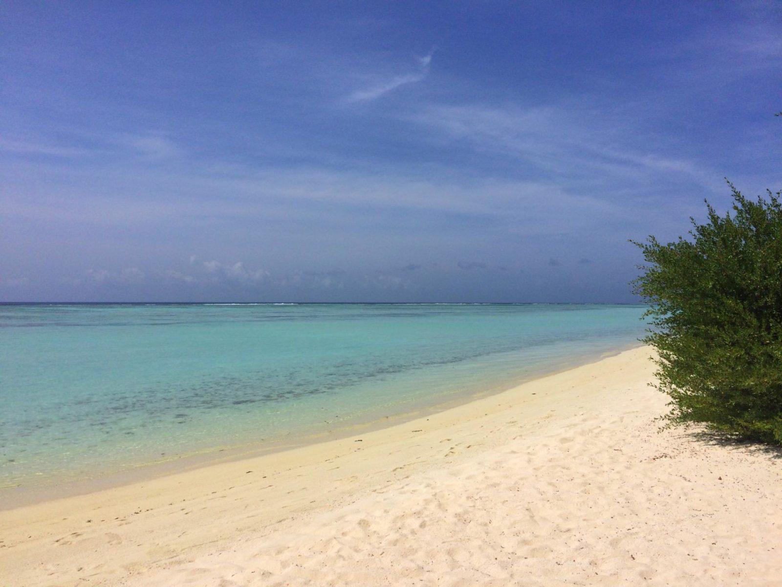 white sand beach turquoise sea blue skies the maldives